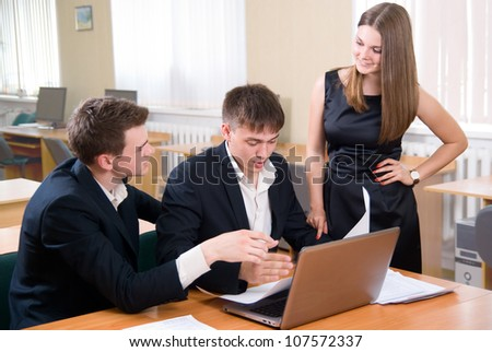 Young people discuss the fresh project.At office - stock photo