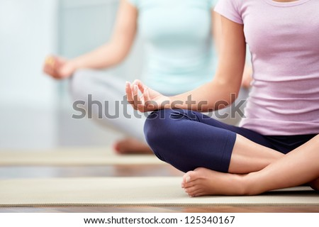 Young people do yoga indoors - stock photo