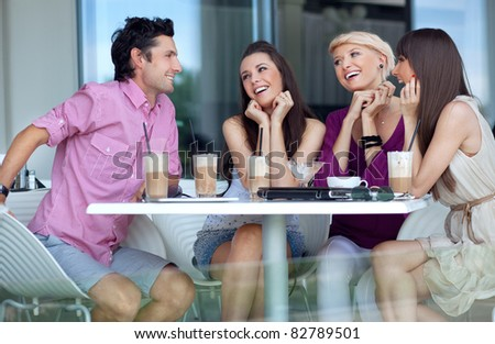 Young people enjoying lunch break - stock photo