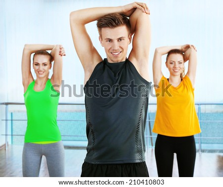 Young people exercising at  gym - stock photo