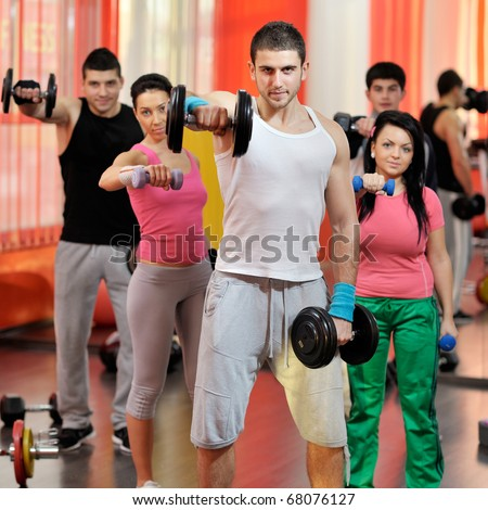 young people exercising in the gym - stock photo