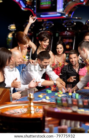 young people exited over playing roulette - stock photo