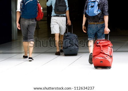 Young people go up the stairs at the station. Beginning of a journey. - stock photo