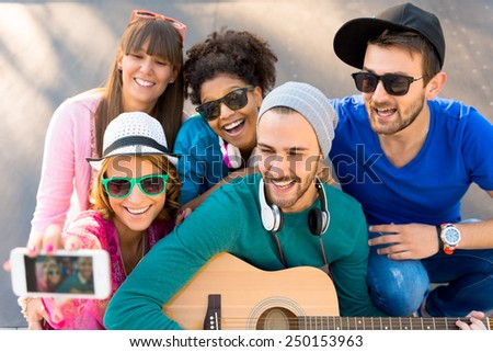 Young people having fun at the skate park - stock photo