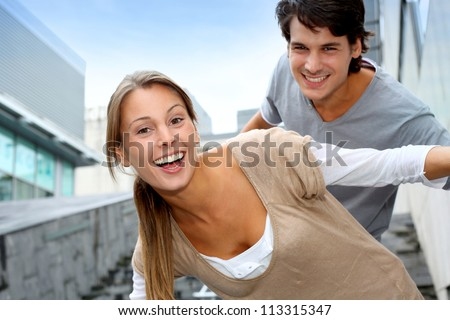 Young people having fun in college campus - stock photo