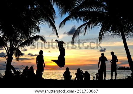Young people having fun in the beach - stock photo