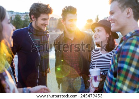 Young people in real authentic life on city street - stock photo