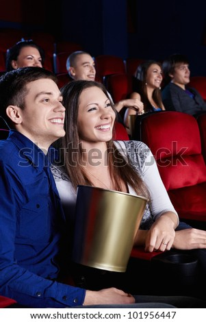 Young people in the cinema - stock photo