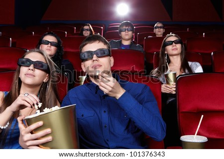 Young people in the cinema in 3D glasses - stock photo