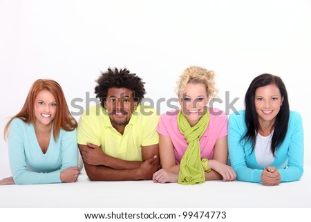 young people lying on the floor - stock photo