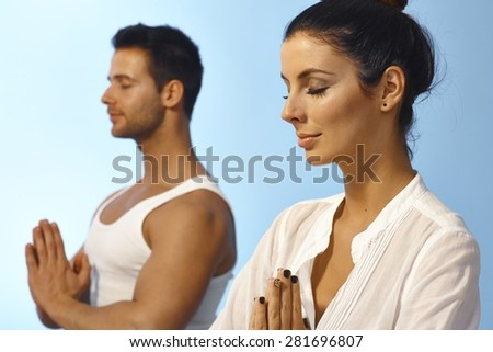 Young people meditating in peace eyes closed. - stock photo