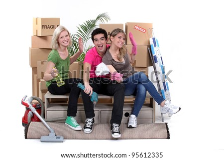 Young people moving home - stock photo
