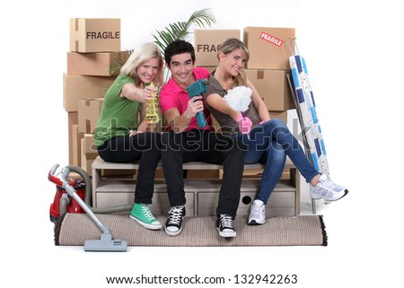 Young people moving in together - stock photo