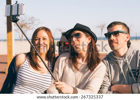 Young people on a spring afternoon doing a selfie - stock photo