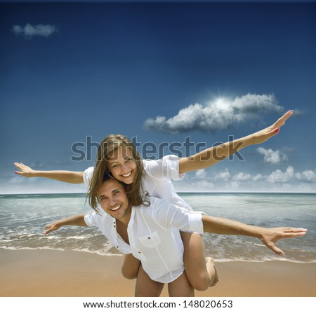 young people on a tropical beach - stock photo