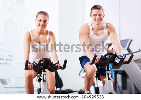 Young people on bikes in the gym - stock photo