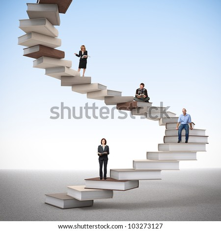 young people on 3d book pile - stock photo