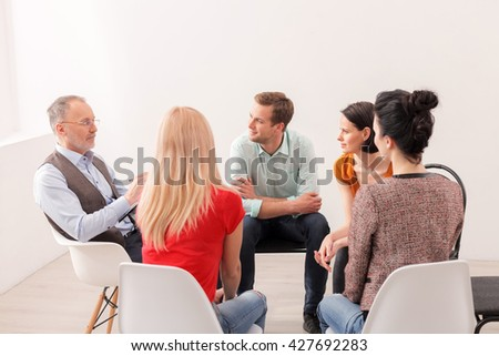 Young people on group therapy session - stock photo