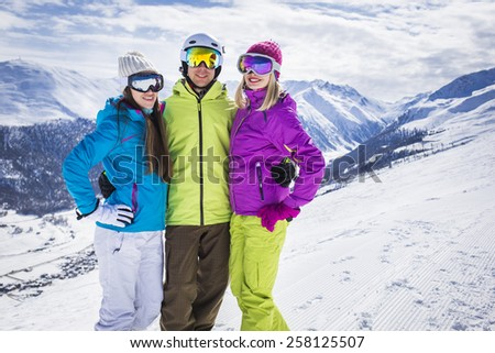 Young people on ski alpine mountain winter resort - stock photo