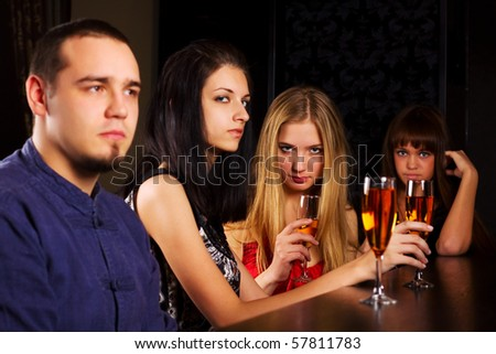 Young people relaxing in a night bar. - stock photo