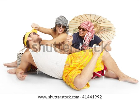 Young people represent that they are on the beach - stock photo