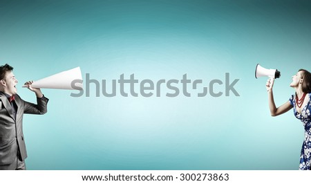 Young people screaming at each other in trumpet - stock photo