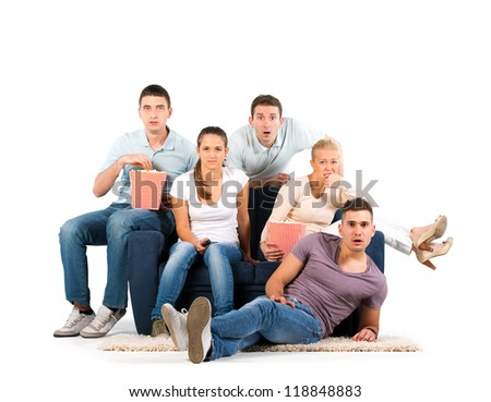 Young people sitting on a sofa. Anticipation. On white background - stock photo