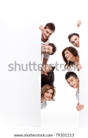young people smiling behind advertising banner - stock photo
