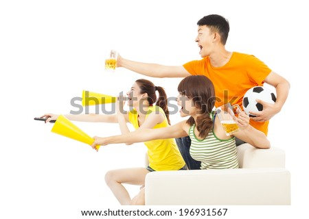 young people so excited to yelling  and while watching soccer game - stock photo
