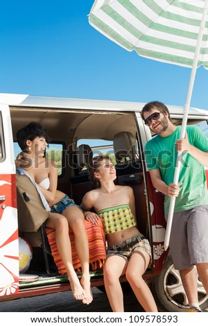 Young people taking break  relaxing in her car near the beach - outdoors - stock photo