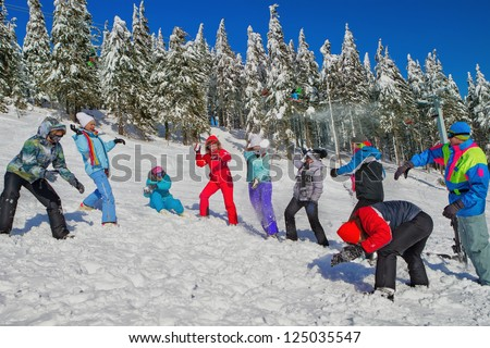 Young people throwing up snow in winter background - stock photo