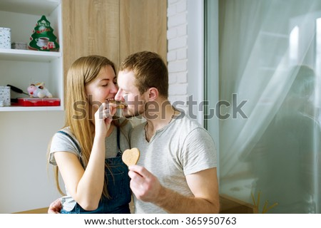 Young people together enjoy taste of ginger cookies - stock photo