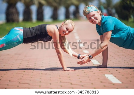 Young people training push up exercise together - stock photo