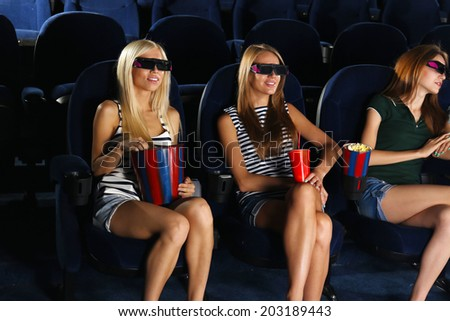 Young people watching movie in cinema - stock photo