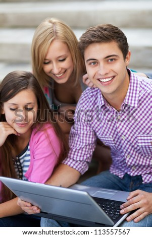 Young people with laptop - stock photo