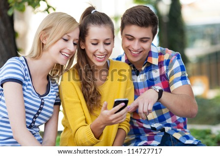 Young people with mobile phone - stock photo