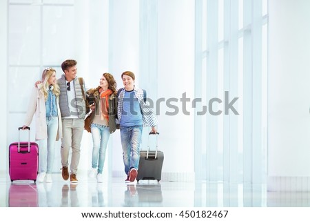 Young people with suitcase in airport - stock photo