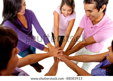 Young people with their hands together in the middle ? teamwork concepts - stock photo