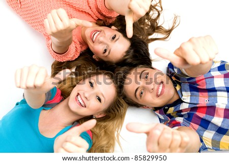 Young people with thumbs up - stock photo