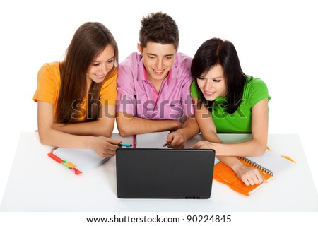 Young people working on a laptop, top angle view of three students sitting at the desk, isolated over white background - stock photo