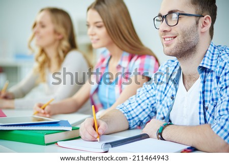 Young people writing lecture - stock photo
