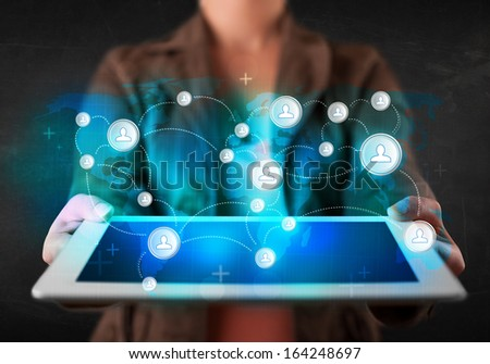 Young person holding tablet with earth communication technology concept - stock photo