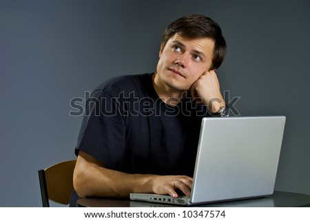Young person works with the computer - stock photo