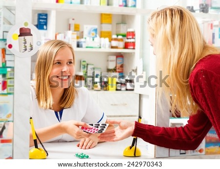 Young pharmacist serving sick patient with the right treatment.  - stock photo