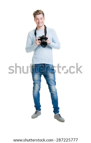 Young photographer holding a dslr photo camera isolated on white - stock photo