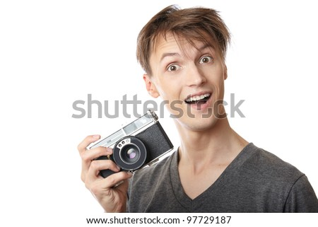 Young photographer holding vintage film photo camera - stock photo