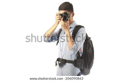 Young photographer taking pictures with digital camera - stock photo