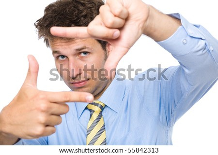 young photographer trying to compose a frame for photograph using his hands and fingers, studio shoot isolated on white background - stock photo