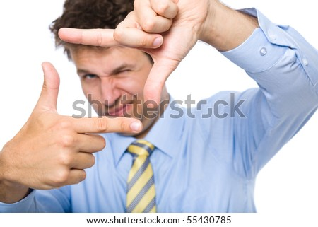 young photographer trying to compose a frame for photograph using his hands, studio shoot isolated on white background - stock photo