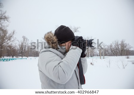 Young photographer with camera - stock photo